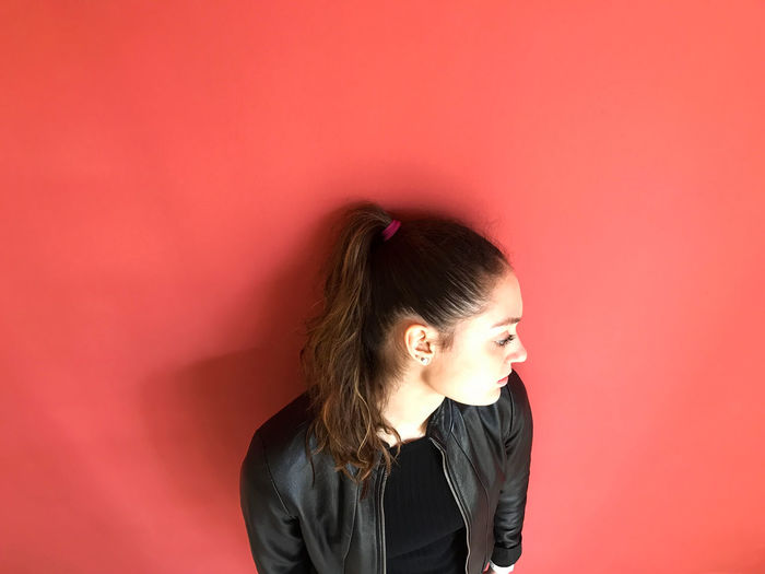 High Angle View Of Teenage Girl Standing Against Wall