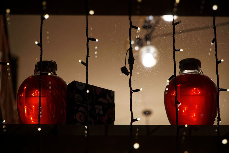 Decorative bottles Jar Bottle Decorative Lights Decorative Object Red Illuminated Indoors  Lighting Equipment No People Night Light Close-up Decoration Still Life Container Focus On Foreground Reflection Technology Table Hanging Glowing Electricity  Creativity Glass Electric Lamp