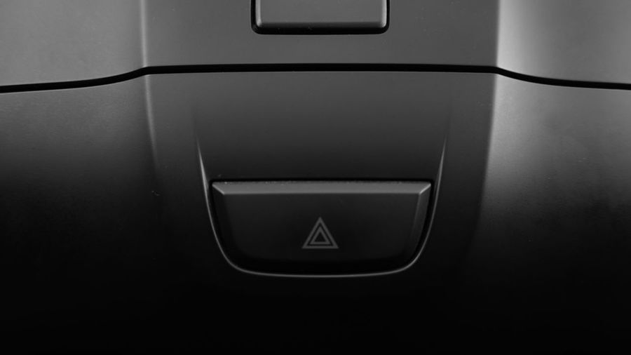 Close-up of push button on car door