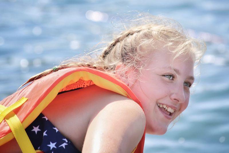 Smiling girl against sea