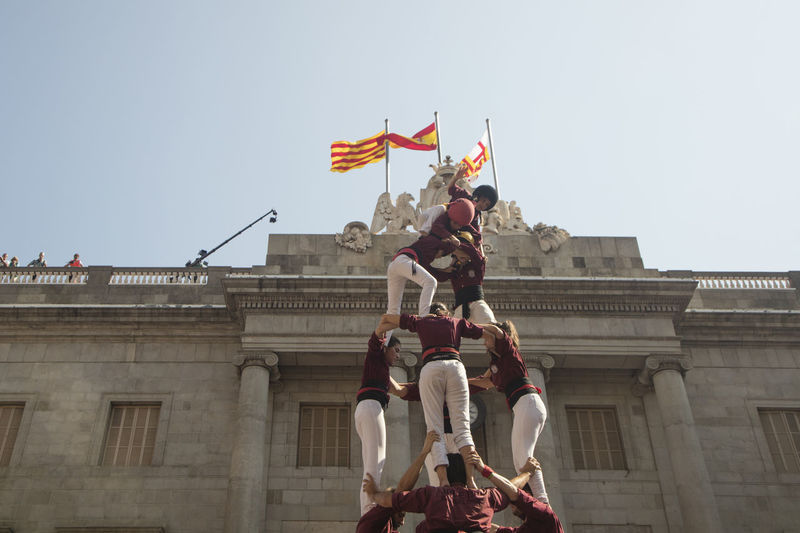Barcelona, Spain - September 24, 2017 Casteller activities in La Merce festivities at Sant Jaume Square, Barcelona. 2017 Barcelona Catalonia Catalonia Is Not Spain Celebration Democracy Freedom La Merce Festival Protest SUPPORT Sant Jaume Teamwork Castellers Celebration Event Celebrations Cooperation Demonstration Festival Freedom Of Expression La Merce Performance Performing Arts Event Rally