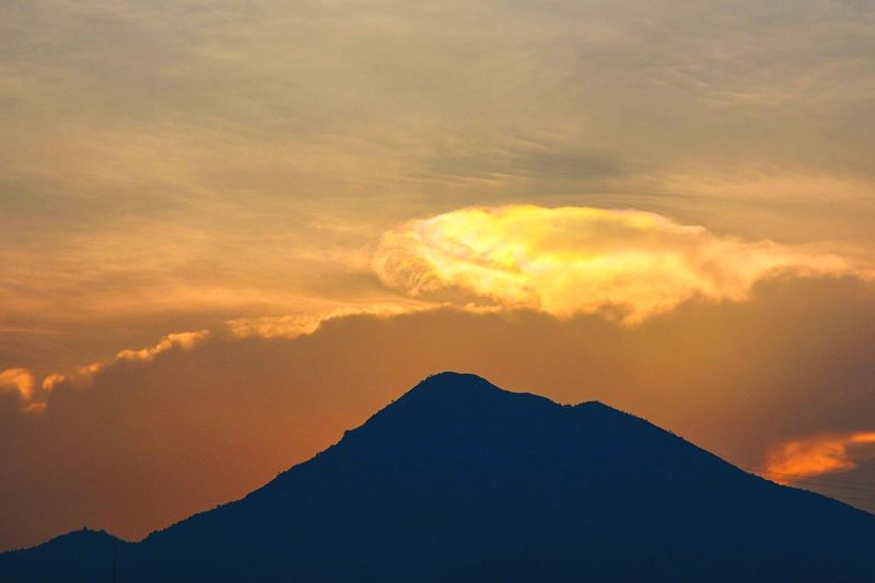 Iridescent clouds seen above Needle Hill, Hong Kong. Iridescent Clouds Hill Hong Kong Beauty In Nature Sky Nature Silhouette Sunset Scenics Tranquility Mountain Cloud - Sky Tranquil Scene Outdoors
