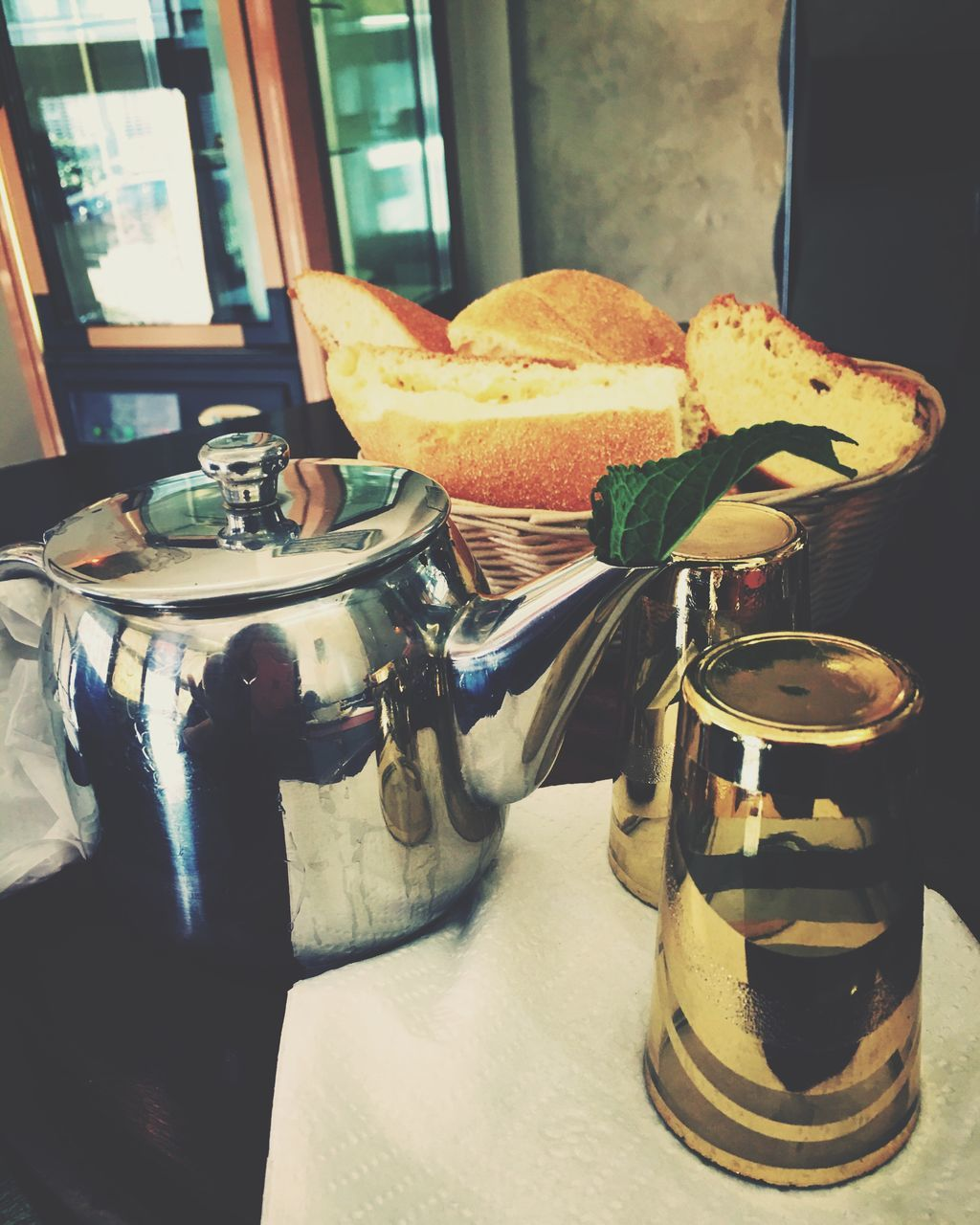High Angle View Of Teapot And Bread On Table