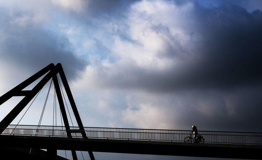 Abendsonne Architecture Biker Bridge Brunette Clouds And Sky Day Düsseldorf Am Rhein Fahrradfahrer Medienhafen One Person Outdoors Railing Sky