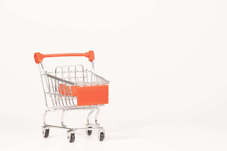 cart on white background Shopping Copy Space Consumerism Retail  Shopping Cart No People Empty White Background Supermarket Studio Shot Indoors  Buying Finance Store Cut Out Container Business Metal Single Object Shopping Basket Sale