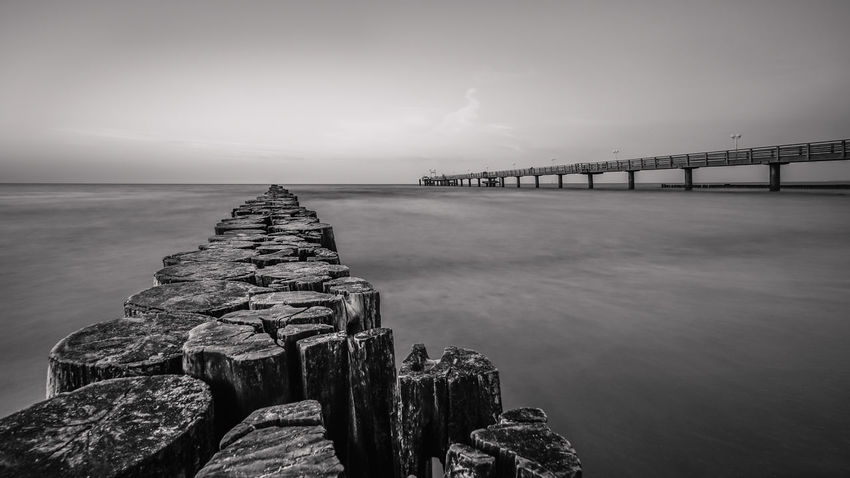 Black and White Bridge at the Waterfront of Kühlungsborn Black & White Architectural Column Architecture Bay Beauty In Nature Bridge Bridge - Man Made Structure Built Structure Cloud - Sky Connection Day Horizon Horizon Over Water Long Nature No People Outdoors Scenics - Nature Sea Sky Tranquil Scene Tranquility Transportation Water Wooden Post