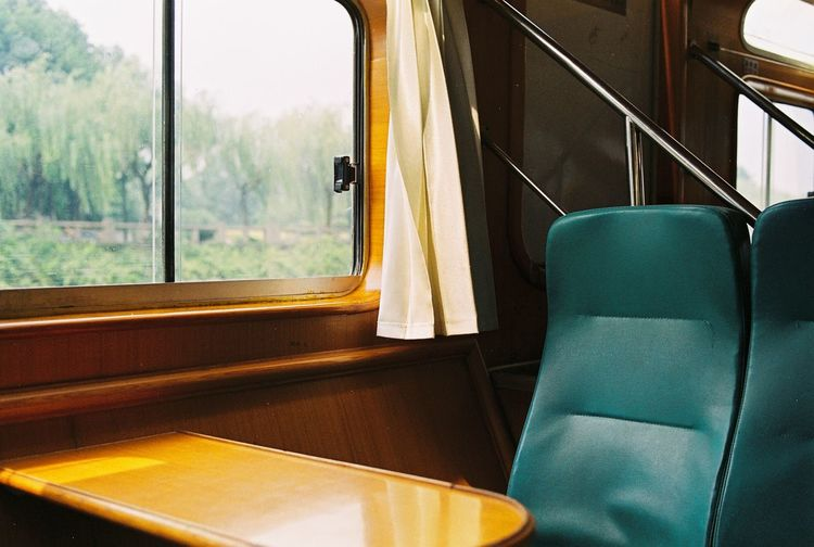 Empty Chairs By Table In Train
