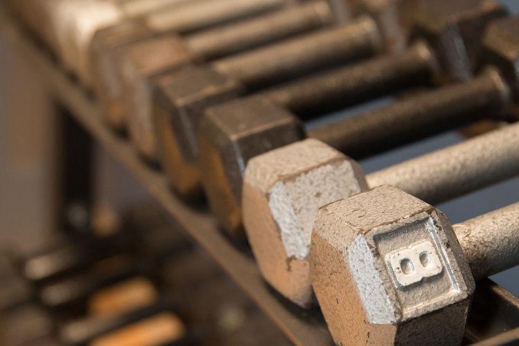 Dumbbells on metal rack in gym