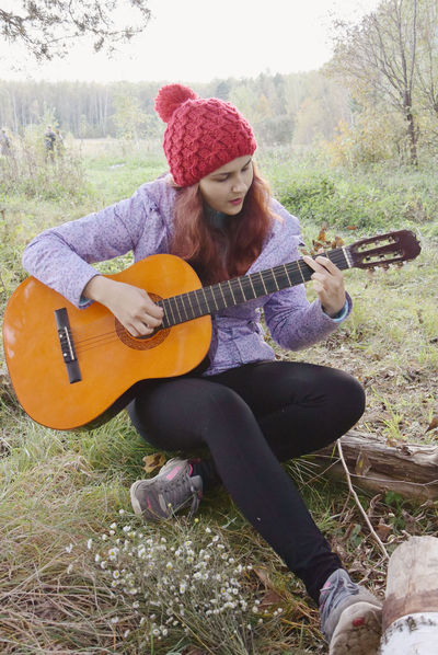 Autumn Campaign Casual Clothing Day Eye4photography  Field Focus On Foreground Forest Full Length Grass Grassy Guitar Leisure Activity Nature Outdoors People Person Relax Relaxation Sitting Songs Songs I Love Toddler  Young Adult Women Around The World