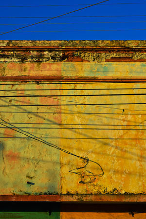 Building detail with wires and shadows in Merida, Mexico Architecture Cable Day Detail No People Outdoors Power Line  Shadows Sky Sunlight Wires, Paint, Decay, Merida, Mexico, Yucat Yellow