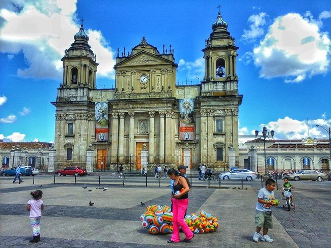 Guatemala Guatemala City Guatemalasecrets Blue Sky And Clouds Blue Sky People Photography People And Places People Walking  People On The Street Random People Street Photography Streetphoto Colors Of Life Balls Church Architecture Catholic Church Catholicchurch Children Photography Children Playing Embrace Urban Life