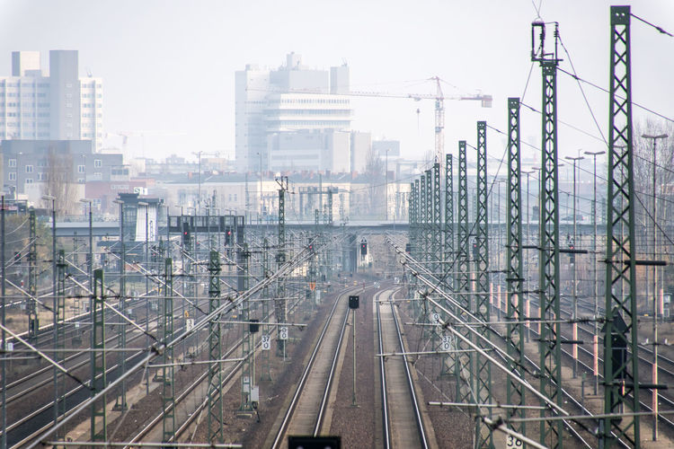 Berlin Photography Logistics Mobility In Mega Cities Public Transportation Rails Skyline Architecture Building Exterior Built Structure City Complexity Day Electricity Pylon Logistic Moabit No People Outdoors Public Transport Rail Transportation Railroad Track Railway Track Sky Transportation Urban Skyline