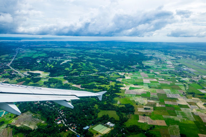 Aerial View Agriculture Aircraft Wing Airplane Beauty In Nature Cloud - Sky Flying Green Color Horizon Landscape Looking Through The Window Nature Outdoor Outdoors Pattern Philippines Residential  Scenics Sky Tourism Travel Vacation Wing EyeEmNewHere Flying High