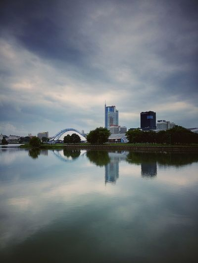 Minsk Reflection Tranquility Cloud - Sky Sky Lake Symmetry Water Outdoors No People Travel Destinations Architecture Nature City Day