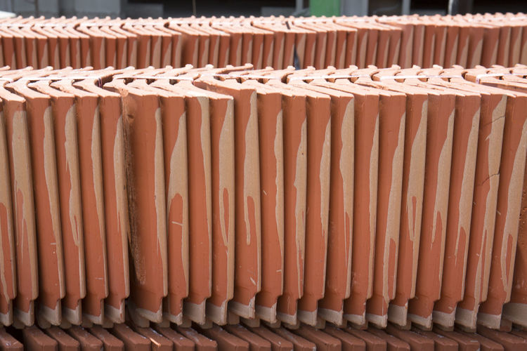 Building Material Repetition Brown No People Full Frame In A Row Pattern Large Group Of Objects Day Arrangement Side By Side Backgrounds Orange Color Container Still Life Built Structure Architecture Outdoors Order Stack Close-up Roof Tile Contruction Zone Material Photography Color Image