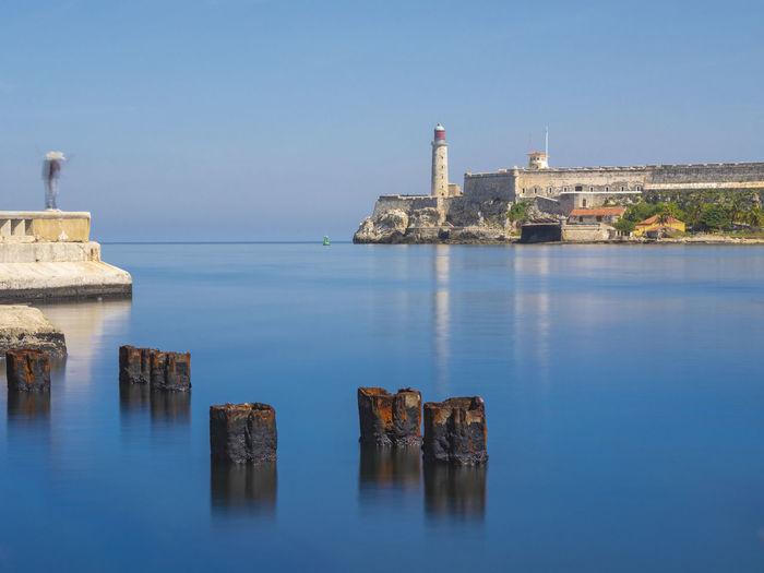 Calm and quiet Blue Blue Sky Landmark Havana Cuba Rust Long Exposure Fishing Scenics Seascape Cityscape City Water Sea History Sky Architecture Building Exterior Lighthouse Castle Coast Fortified Wall Old Ruin The Past Shore Horizon Over Water Fortress