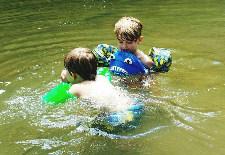Shirtless Boys Swimming In Lake