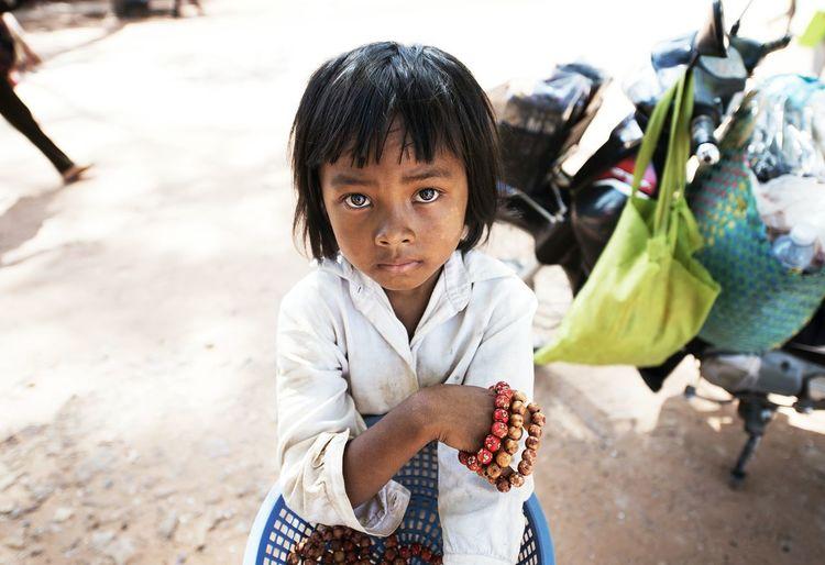 Portrait of girl selling bracelet
