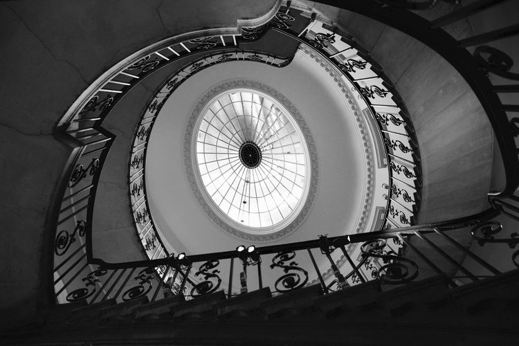 Looking up towards the ceiling at the bottom of one of Somerset House's staircases. Bannister Black And White Ceiling Design Indoors  Lookingup Somerset House  Spiral Staircase Window Interior Views The Architect - 2016 EyeEm Awards Eyeemphoto Monochrome Photography London Lifestyle Welcome To Black