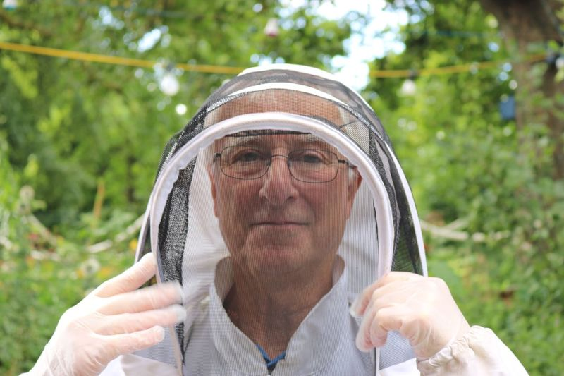 EyeEm Selects One Person Real People Front View Focus On Foreground Headshot Senior Adult Day Outdoors Leisure Activity Looking At Camera Portrait Lifestyles Close-up Human Hand Adult People Bee Bee Keeping Bee Keeper Outfit Protective Clothing Suit