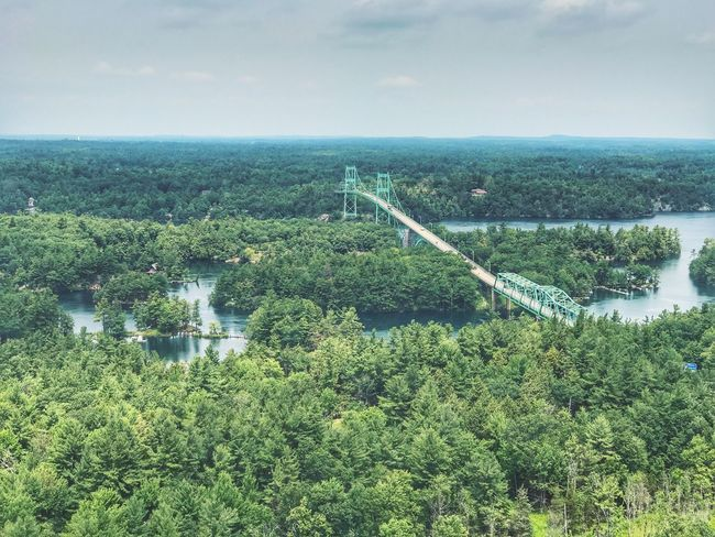 Thousand Islands suspension bridge. Water Nature Sky River Scenics Beauty In Nature Tranquil Scene Green Color No People Day Outdoors Tranquility Tree Growth Plant Bridge - Man Made Structure Landscape Architecture Thousand Island Suspension Bridge Ontario Iphonephotography