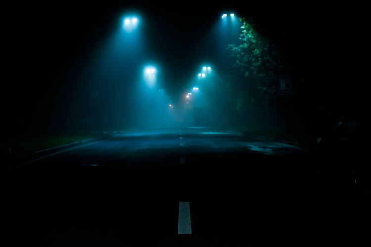 Night Illuminated Road Transportation Dark Street Lighting Equipment City Car No People Motor Vehicle Mystery Sign Direction Mode Of Transportation The Way Forward Street Light Fog Nature Light Nightlife