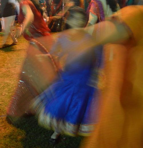 Blurry Blurry On Purpose Celebrating Colours Crowd Dance Dance Night Festivities Garba Chock Garba Dance India Movement New Delhi Orange Outdoors Saree Traditional Indian Dance