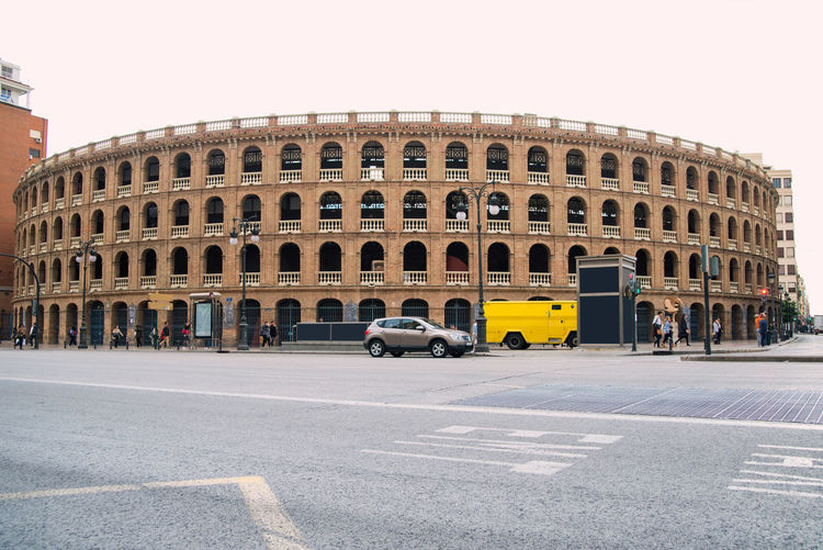 Colosseum landmark in Valencia Spain Architecture Transportation Car Built Structure Mode Of Transportation Motor Vehicle Road Building Exterior City Land Vehicle Street Incidental People Arch Day Symbol Sky Sign History Road Marking Nature Outdoors Coloseum Valencia, Spain