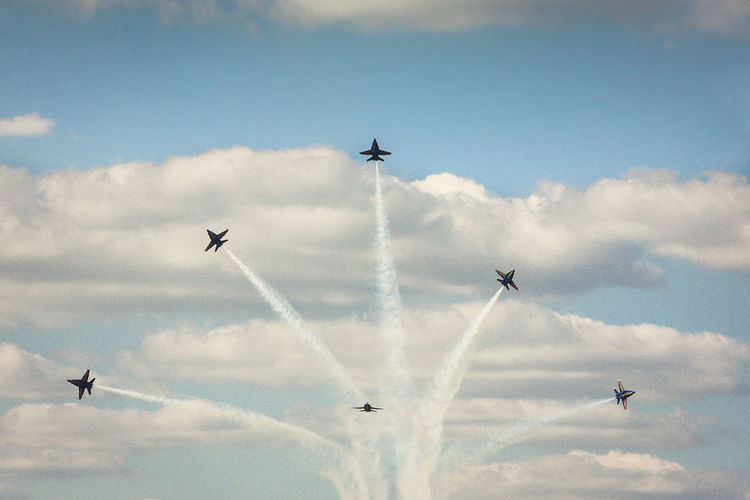 Low Angle View Of Airplanes With Vapor Trail During Airshow