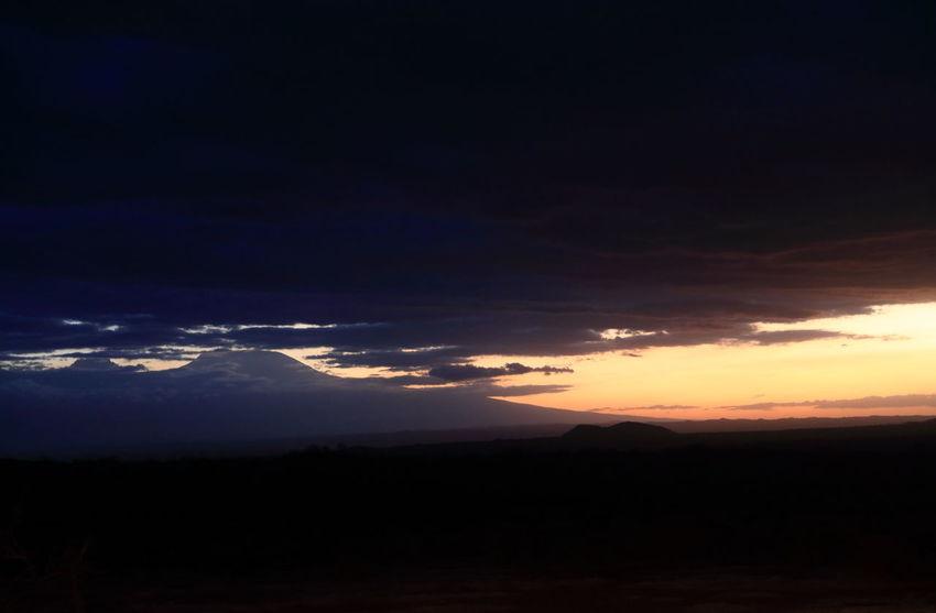 sunset over Kilimanjaro seen from Tsavo West NP, Kenya Atmospheric Mood Dramatic Sky Kenya Kilimanjaro Landscape Majestic Mountain Peak Mountain Range National Parks Kenya Physical Geography Snowcapped Mountain Storm Cloud Sunset Over Kilimanjaro Tourism Tranquility Travel Destinations Tsavo West