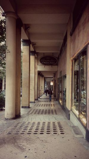 Street Photography Urban Geometry Architecture Old Buildings Looking Through The Columns  Man Walking Perspective