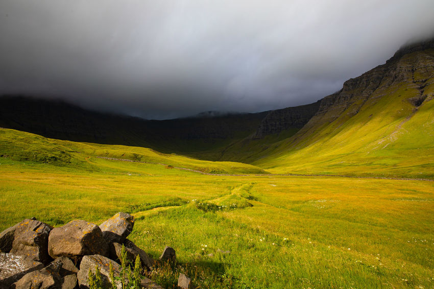 Gasadalur Tadaa Community Beauty In Nature Cloud - Sky Environment Faroe Islands Grass Green Color Idyllic Land Landscape Mountain Mountain Range Nature No People Non-urban Scene Outdoors Plant Remote Scenics - Nature Sky Tranquil Scene Tranquility Travel Destinations Valley