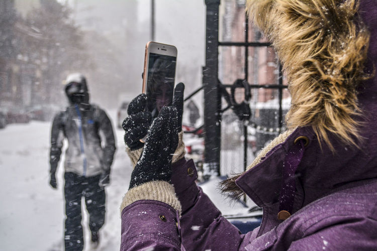 Close-Up Of Woman Photographing During Winter