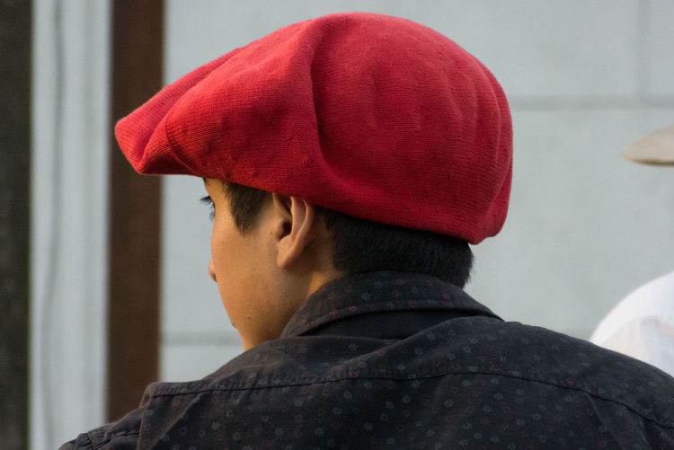 Headshot Real People Clothing Red Portrait One Person Hat Lifestyles Men Close-up Child Cap Boys Focus On Foreground Looking Childhood Side View Day Males  Uniform Innocence Warm Clothing Teenager Teenage Boys