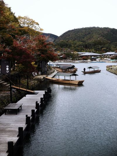 Boats at Arashiyama lake Kyoto Japan Arashiyama Water Tree Nautical Vessel Architecture Transportation Plant Nature Day Mode Of Transportation Lake Tranquility Beauty In Nature Outdoors