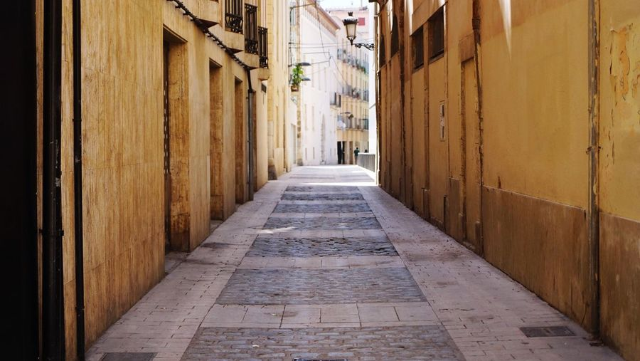 Narrow street Narrow Street Lane Architecture Built Structure Direction The Way Forward Building Exterior Building Diminishing Perspective Footpath City Alley Street Narrow Residential District No People Day Outdoors Empty Arcade