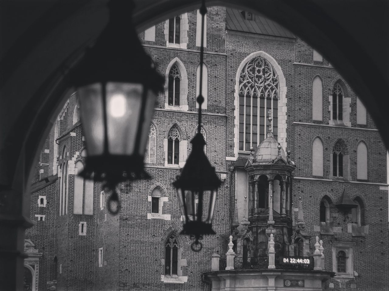 Low Angle View Of Hanging Lanterns Against Built Structure