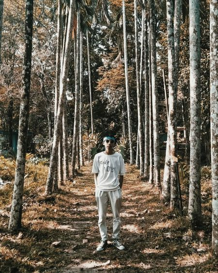 Portrait of man standing in forest