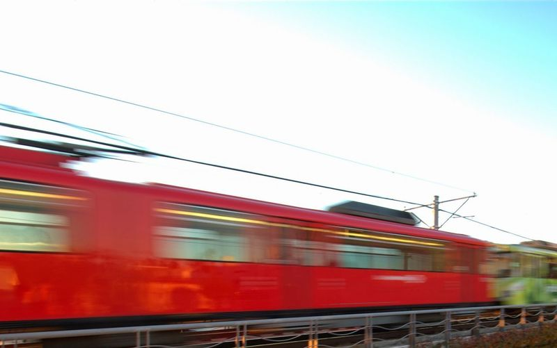 Train at railroad station against clear sky