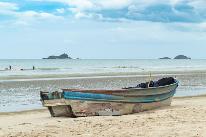 Anchored Beach Beauty In Nature Cloud - Sky Day Fishing Boat Horizon Horizon Over Water Land Mode Of Transportation Moored Nature Nautical Vessel No People Outdoors Rowboat Sand Scenics - Nature Sea Sky Tranquil Scene Tranquility Transportation Water