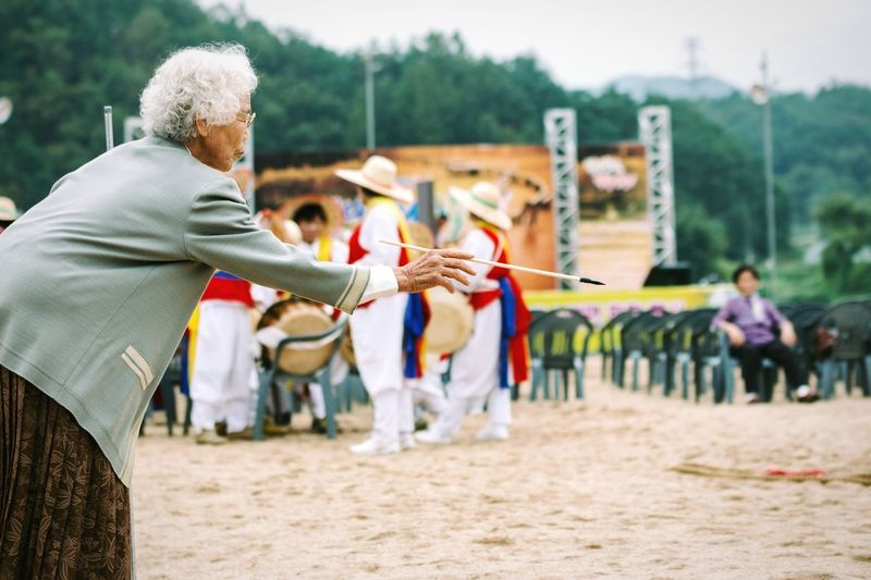 Almost.. Senior Adult Adult Focus On Foreground Playing Person Arts Culture And Entertainment Gray Hair People Outdoors Retirement Capturing Motion Old Lady Grandma Korea Korean Asian Culture Game Senior Old Woman Woman Elderly Arm Arrow Aged Seniors