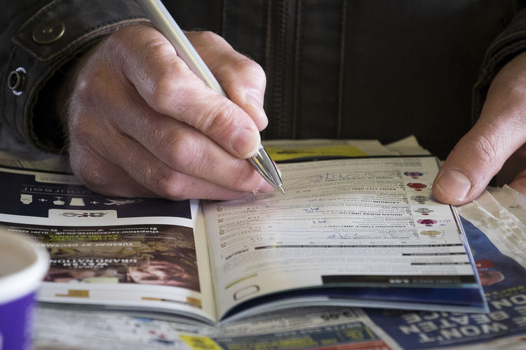 Studying the form Betting Form Guide Gambling Horse Race Horse Races Horse Racing Human Hand Race Card