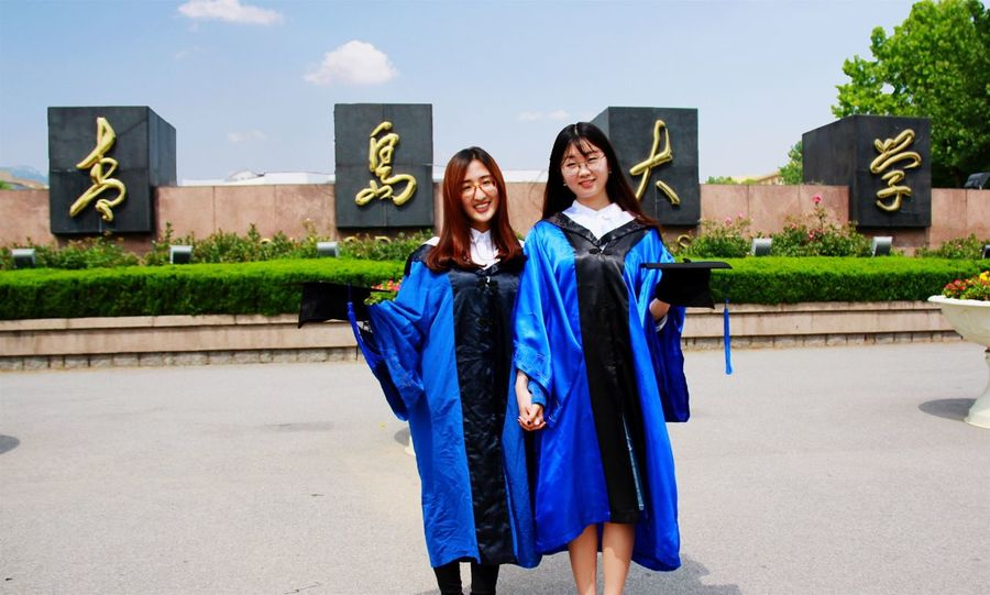 Happiness Achievement Education Smiling Real People Young Adult Young Women University Student Graduation Cheerful Friendship Two People Togetherness University Student Outdoors Campus Celebration Blue Lifestyles 🎓