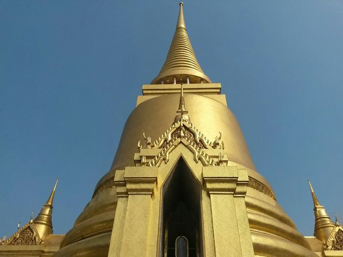 Gold South East Asia Thailand Wat Phra Kaew Architecture Belief Building Building Exterior Built Structure Clear Sky Gold Colored Low Angle View Nature Outdoors Place Of Worship Religion Sky Spire  Spirituality Steeple Temple Tower Travel Destinations