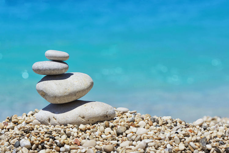 Rock Solid Stone - Object Pebble Stone Balance Stack Rock - Object Sea Water Zen-like Nature Beach Tranquility No People Land Blue Tranquil Scene Day Outdoors Stack Rock