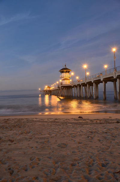 Early morning at Huntington Beach California Architecture Beach Beauty In Nature Building Exterior Built Structure Cloud - Sky Horizon Over Water Huntington Beach CA Illuminated Nature Night No People Outdoors Sand Scenics Sea Sky Sunset Tranquil Scene Tranquility Travel Destinations Water