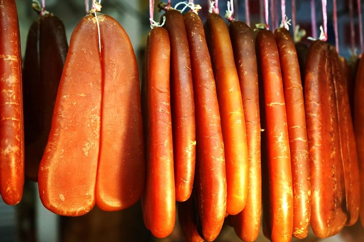 Close-up of meat hanging in shop for sale