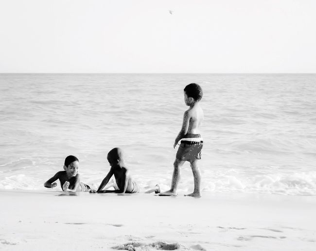Boys chilling By the sea Holidays People Children Nature Summer ☀ People Of The Oceans Beach Shadows & Lights Tranquility Boy Coast