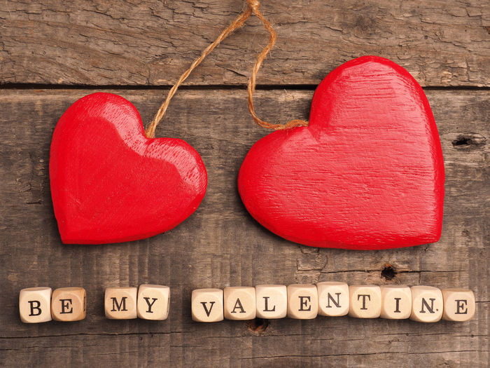 Close-Up Of Heart Shaped Decor And Text On Table