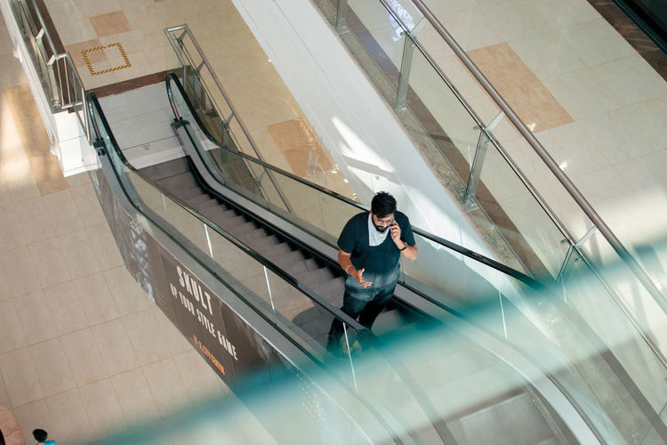 High angle view of man using mobile phone